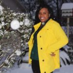 photo of young woman in yellow coat