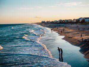 A beach scene at sundown