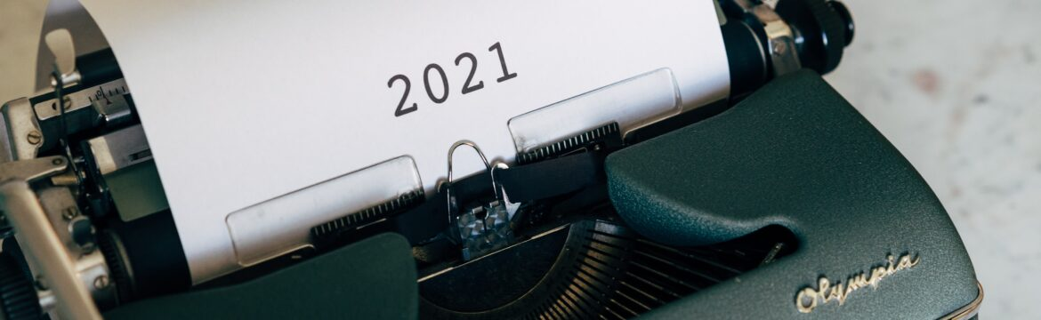 Typewriter with 2021 typed on a sheet of paper