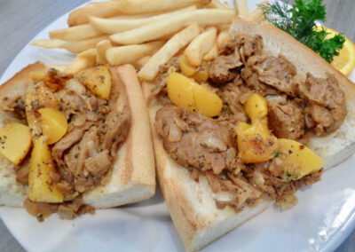 X - New, Cajun Boef with grilled peaches, Replaces Barbecue Beef, which is no longer available