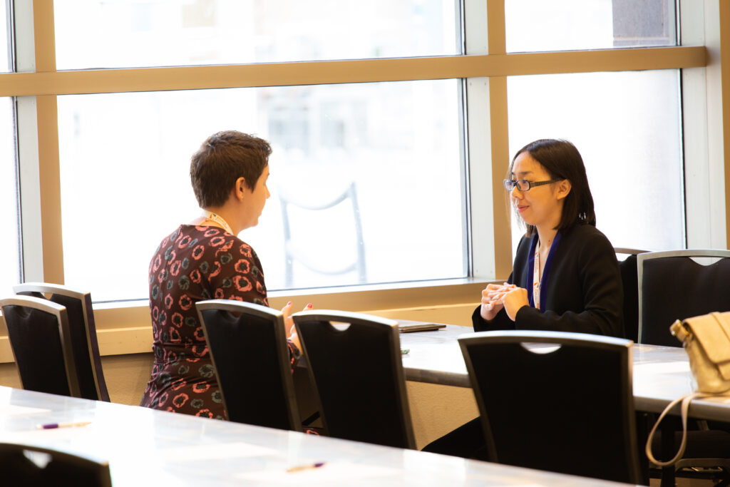 An image of a life science professional speaking with a grad student. Become a member and attend events to make connections like these today.