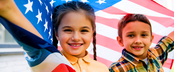 Girl And Boy With The American Flag