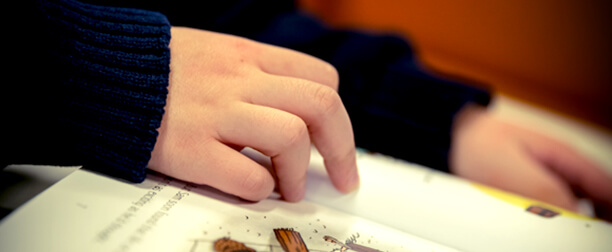Hands Following Along in a Book