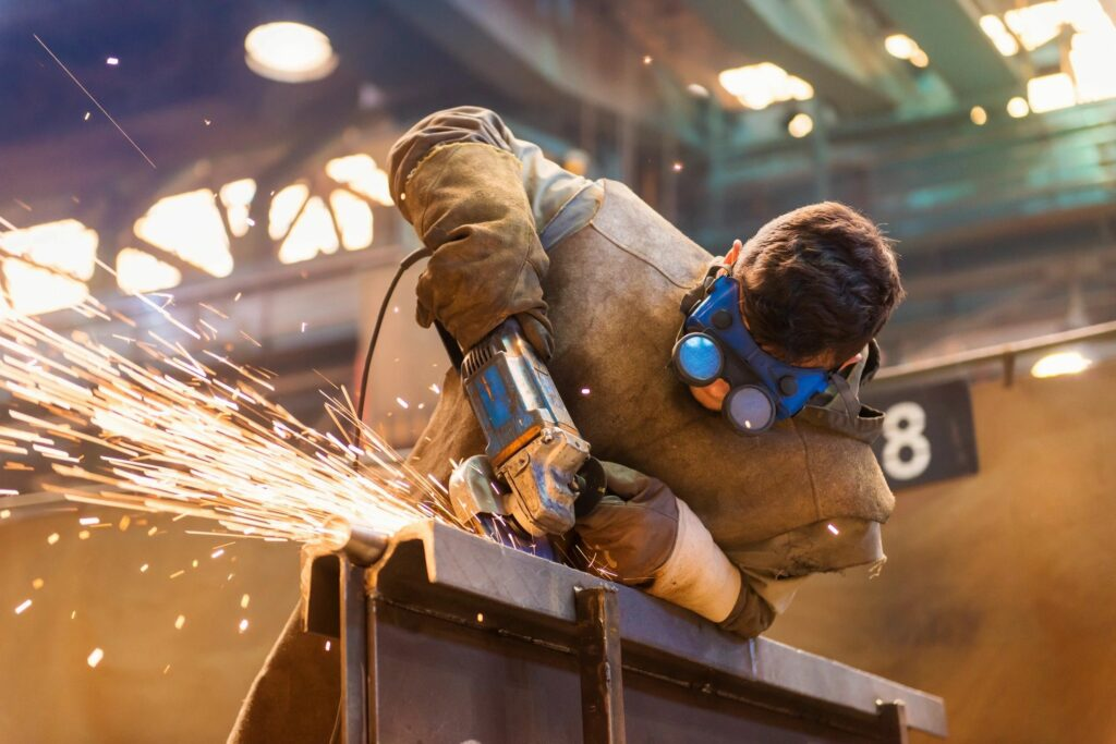 Welder performing fabrication on metal product