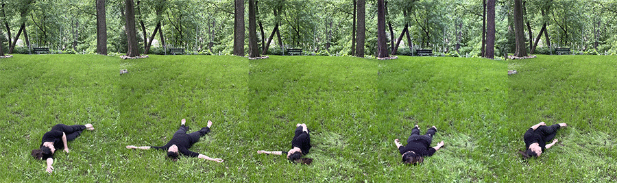 Kelly lays in a field to demonstrate how to roll and pour.