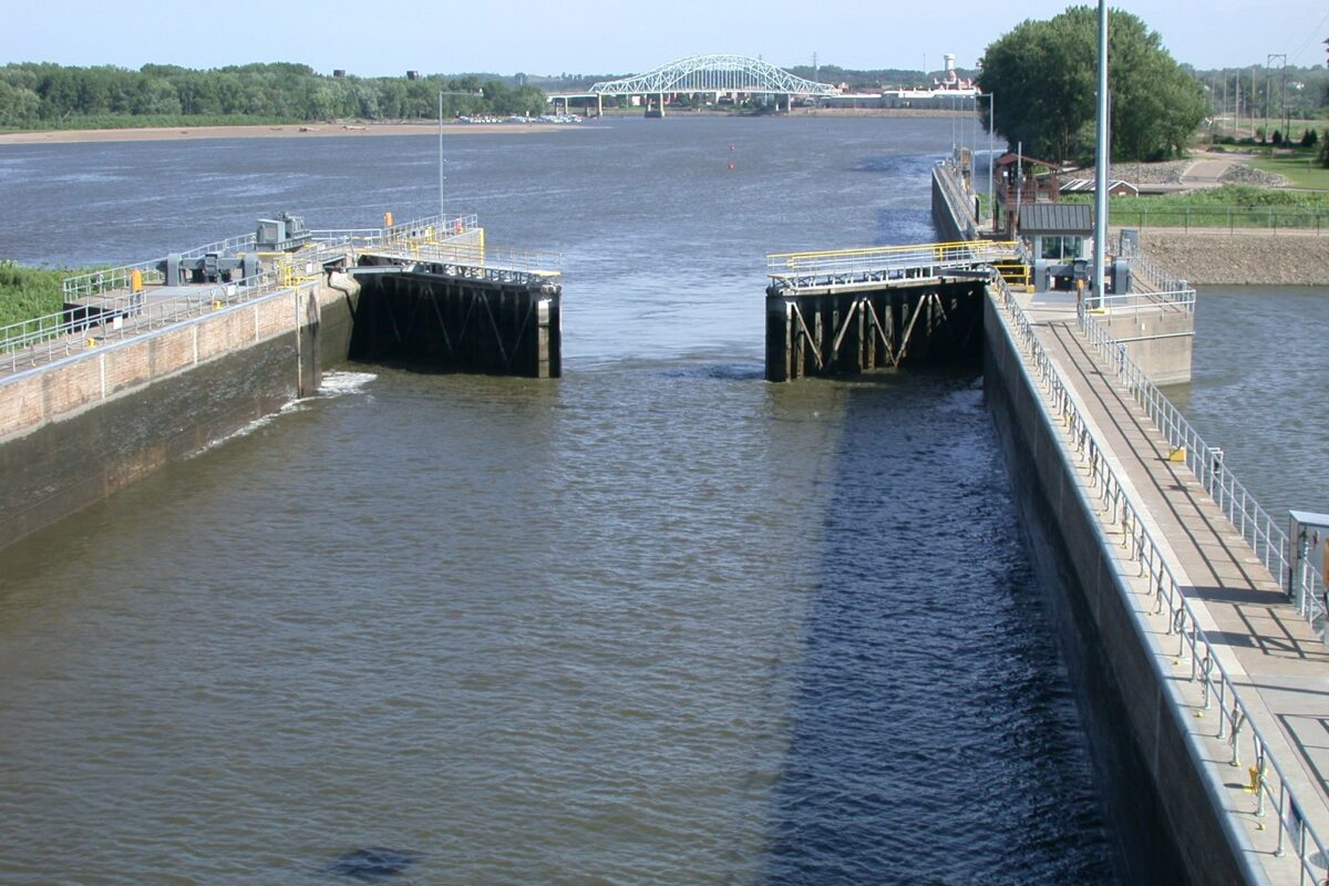 https://secureservercdn.net/198.71.233.129/3zp.bf9.myftpupload.com/wp-content/uploads/2019/11/Lock-and-Dam-2-at-Hastings.-Lock-is-opening-to-float-our-vessel-headed-downriver.-Bridge-in-background-has-been-replaced-1200x800.jpg