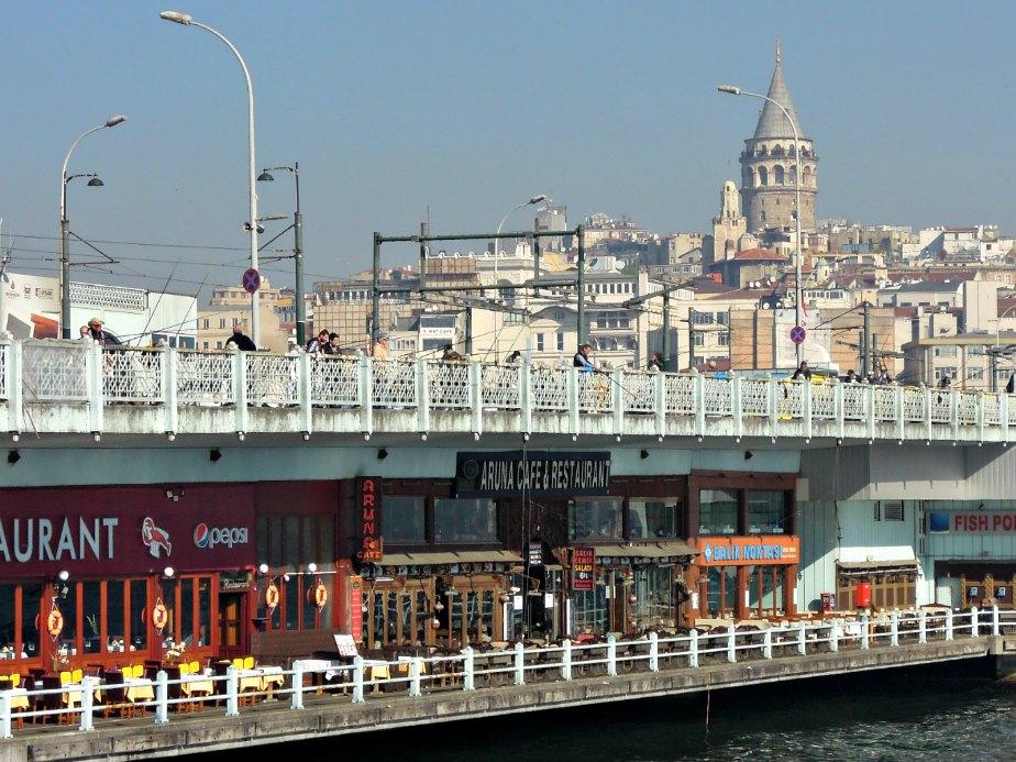 Galata Tower Looks Over the Bridge