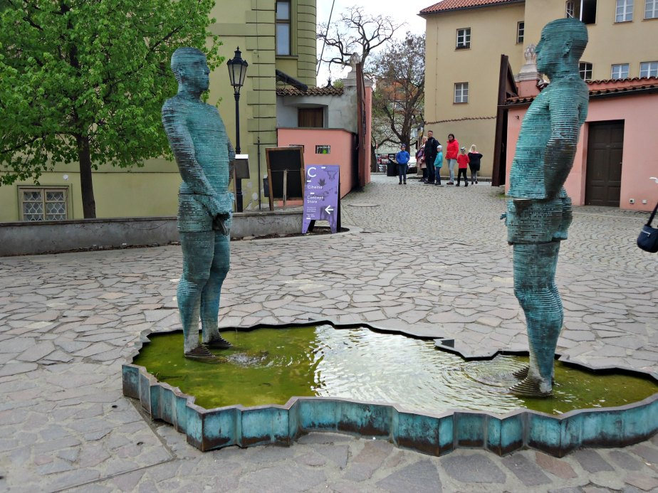"""A Family looks on to """"Piss"""" by David Cerny Prague"""