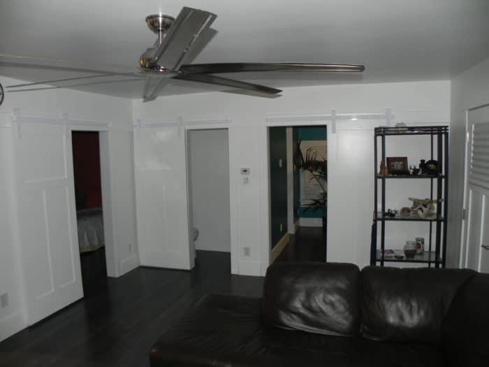 several white sliding doors with white barn door hardware