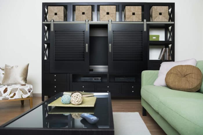 entertainment cabinet with sliding barn style door panels