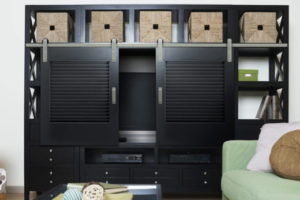 Silver Shutter Series hardware on dark wood living room cabinet