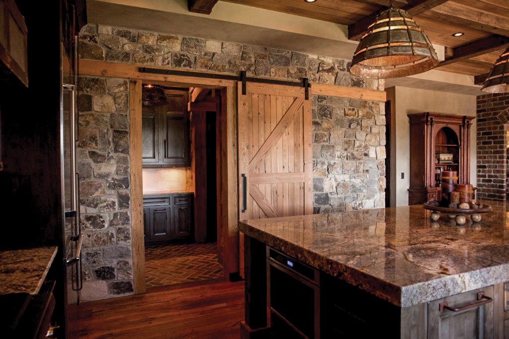 sliding wood kitchen door with black barn door hardware