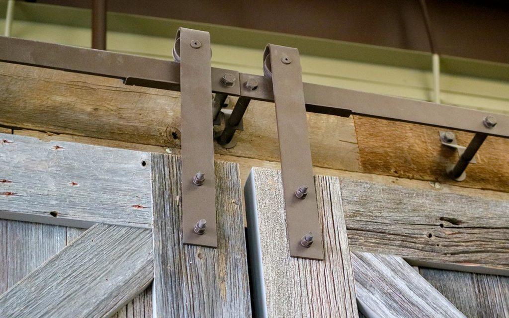 rustic biparting barn doors with brown barn door hardware