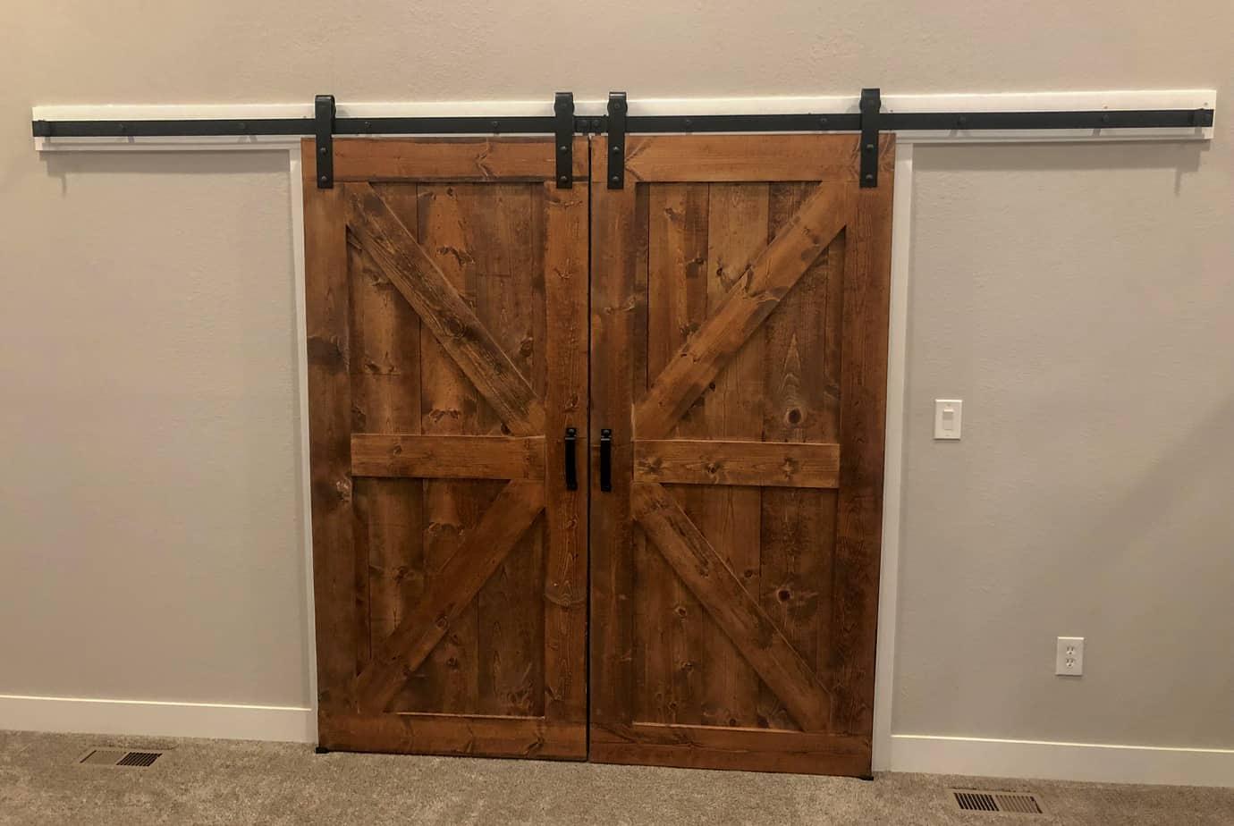 British brace style sliding doors with black barn door hardware