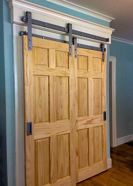 two sliding closet doors mounted on bypass barn door hardware