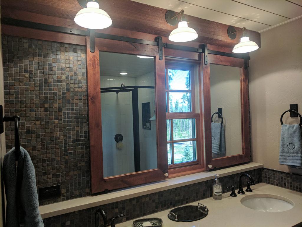 bathroom mirrors mounted on sliding barn door hardware