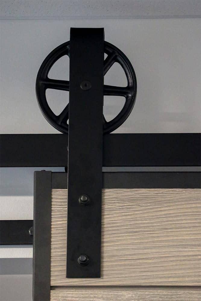 barn door hardware with wagon wheel hanger