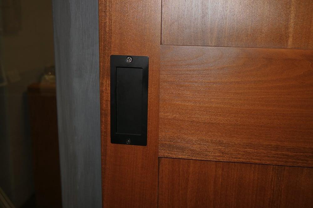 sliding door with black flush pull handle