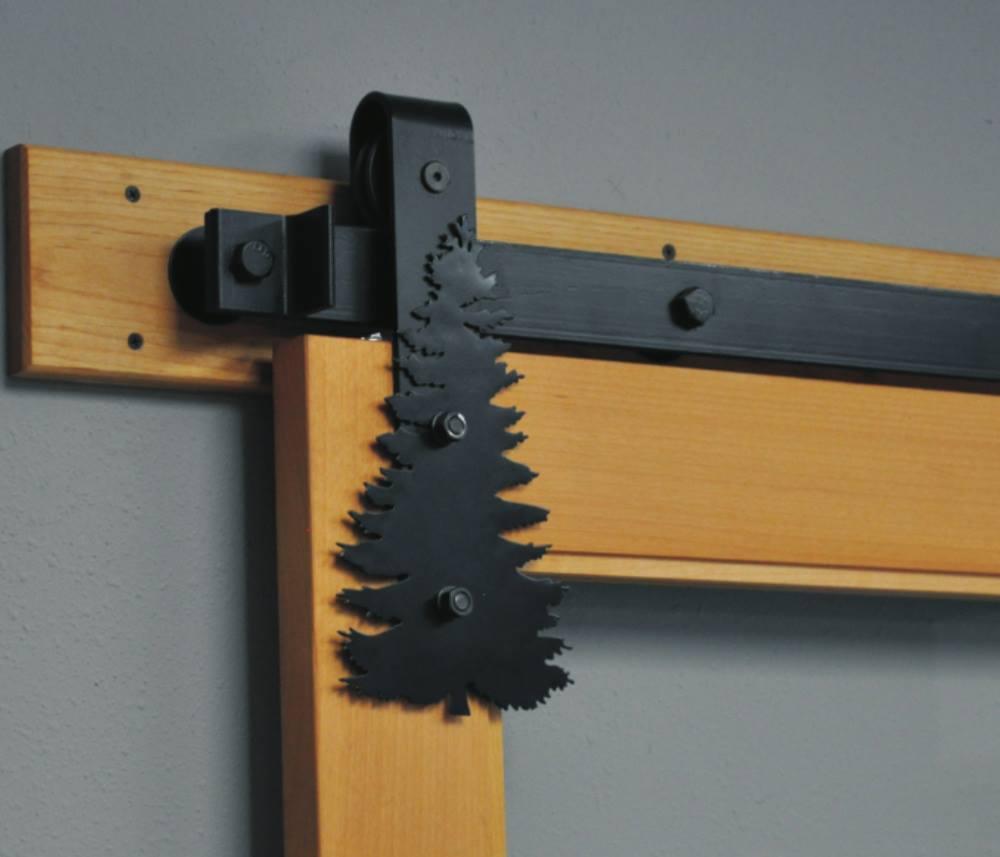 decorative pine tree silhouette on barn door hardware