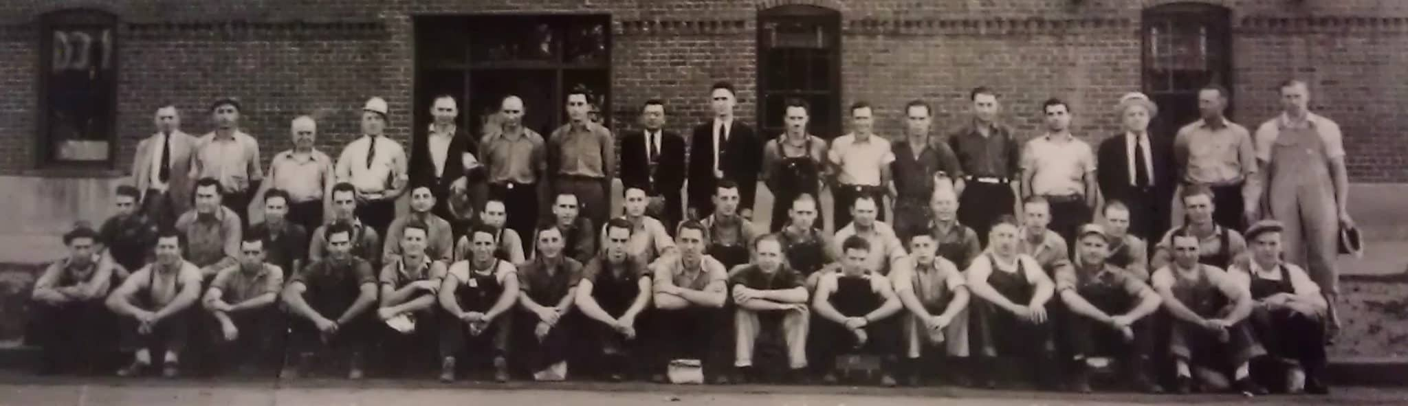historical photo of Goldberg Brothers employees outside Denver factory