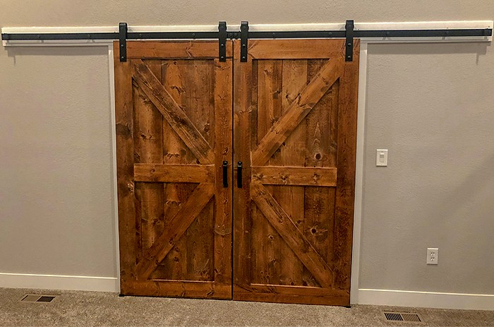biparting sliding doors with Goldberg Brothers barn door hardware