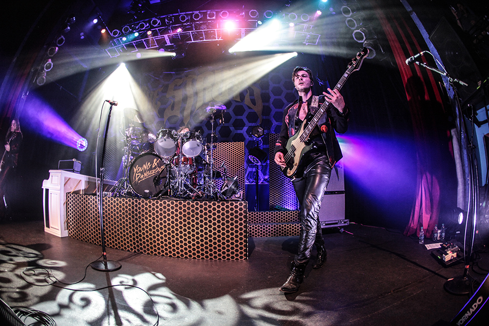 Jed Elliott of The Struts on stage in Denver