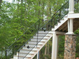 rod iron railings on deck stairway