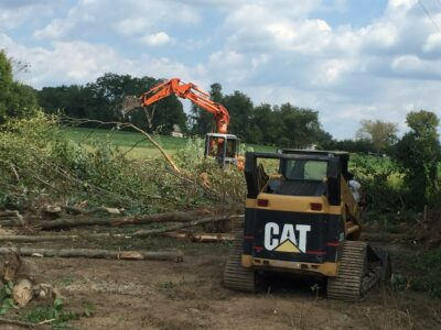 Excavating and clearing land