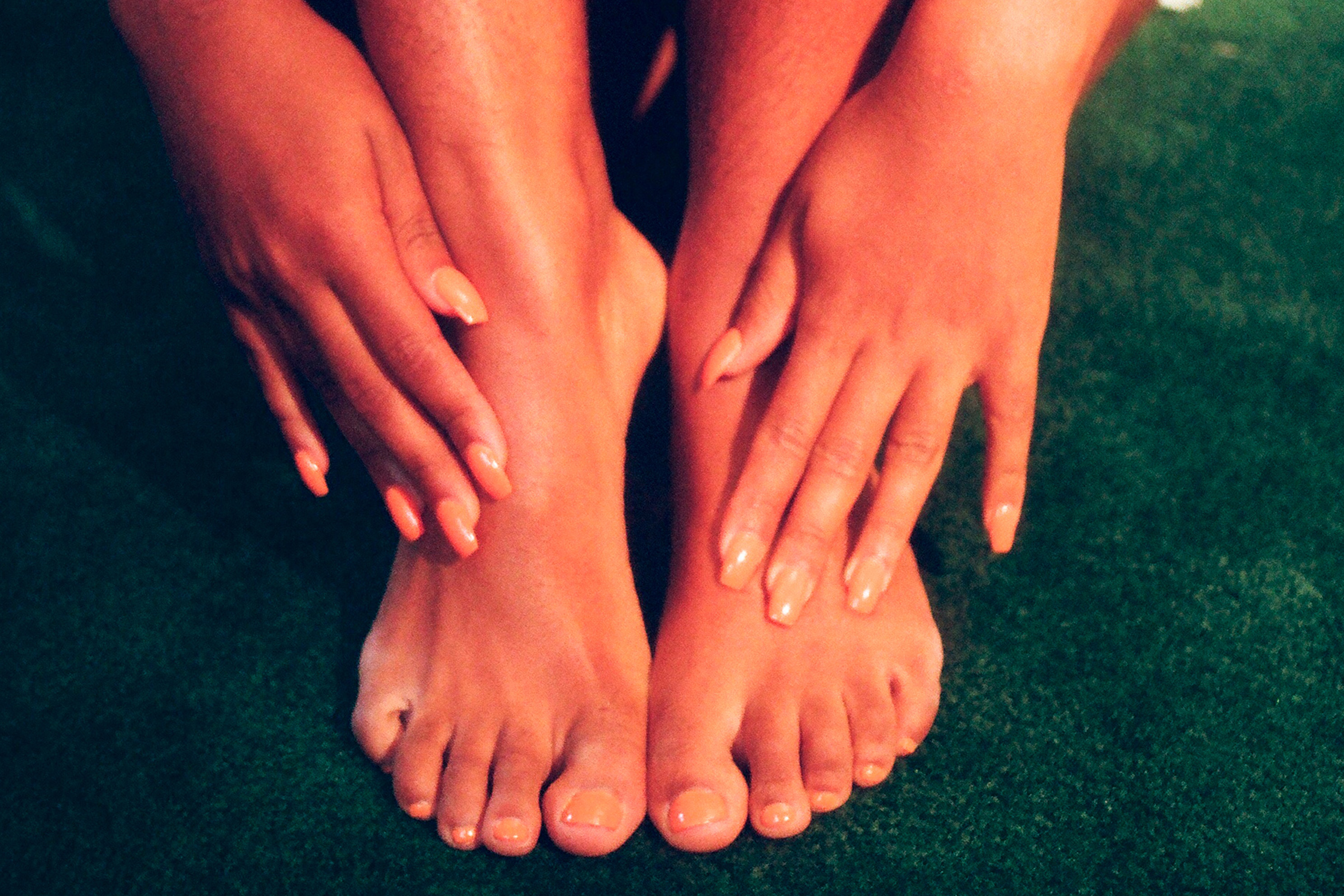 woman's hands and feet with pedicure