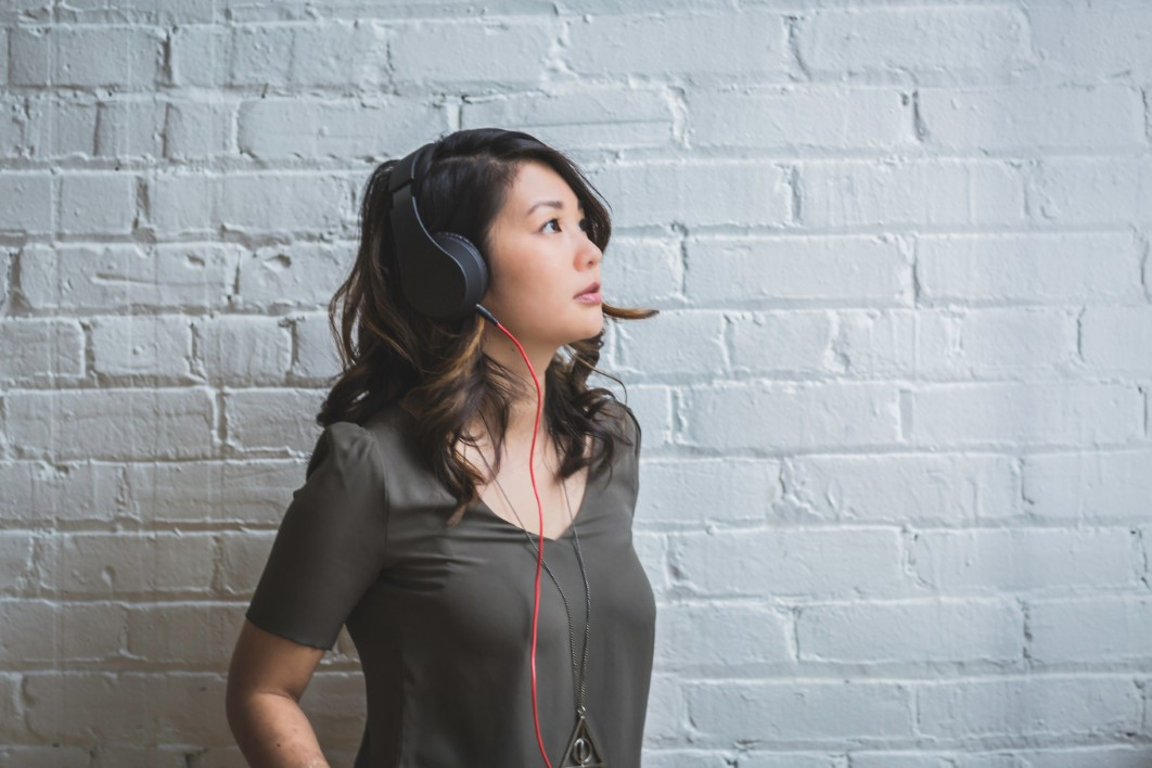 Image of a young woman listening to music with headphones
