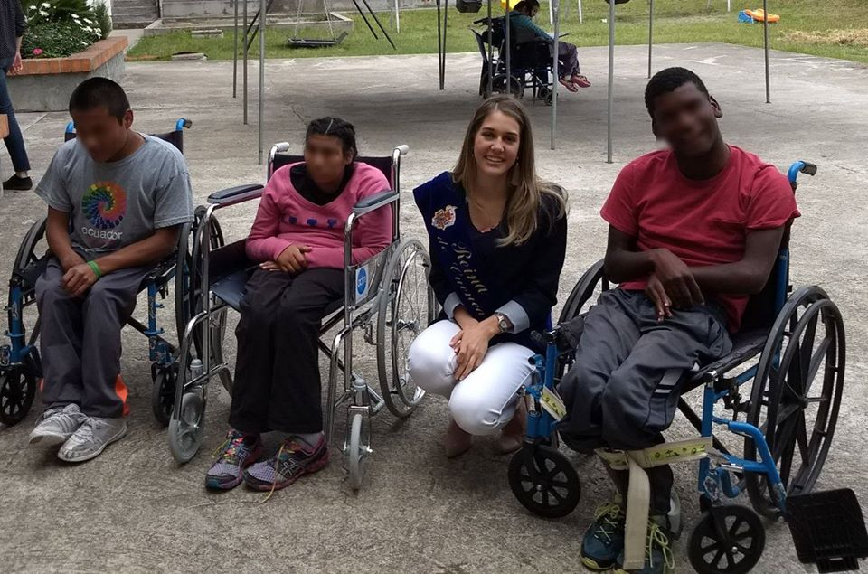 Volunteer working with disabled clients at the OSSO orphanage in Cuenca, Ecuador.