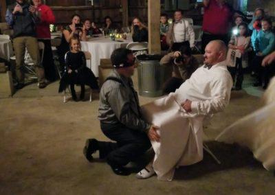 Groomsman wears garter instead of Bride