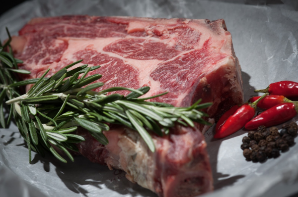 Image of raw meat with herbs