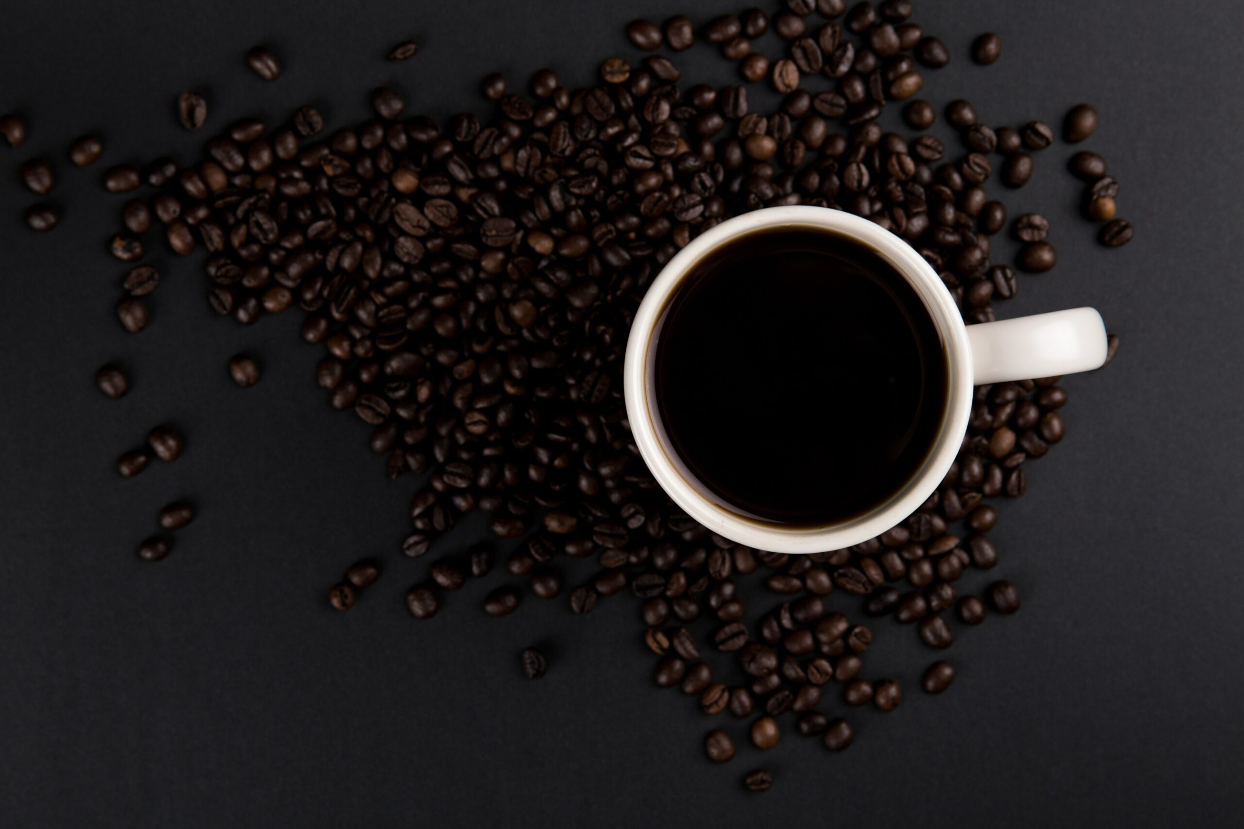 picture of coffee mug and coffee beans