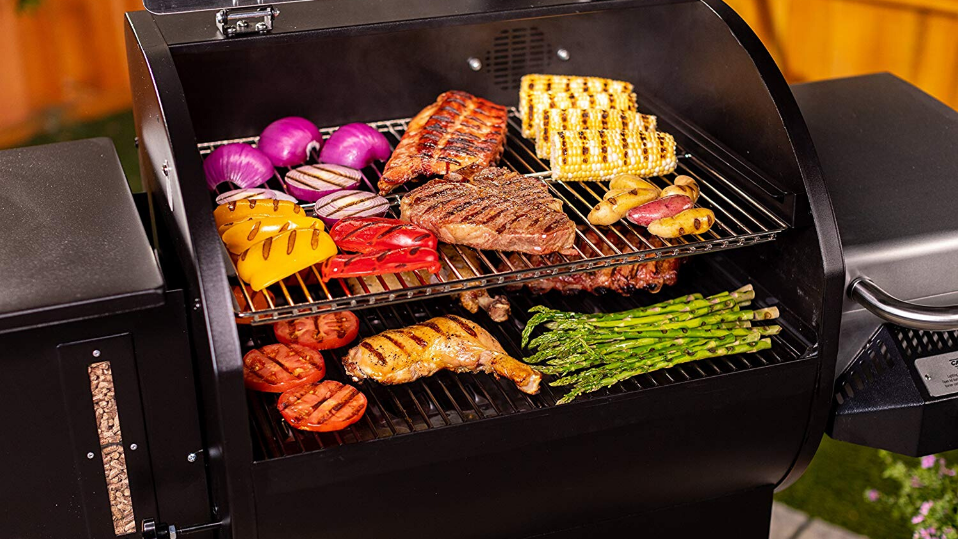 image of meat and veggies grilling on Camp Chef Woodwind SG Pellet grill