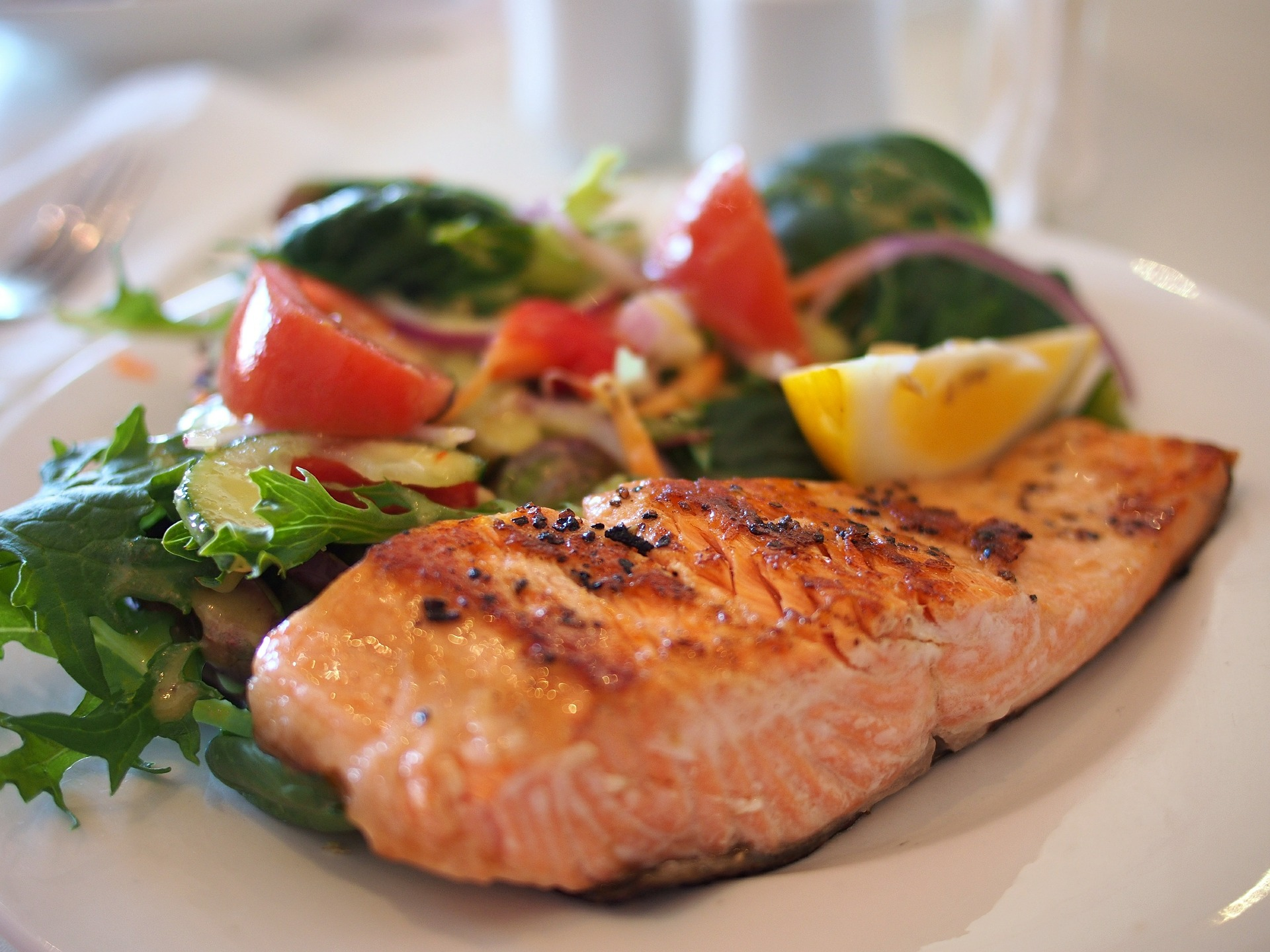 picture of salmon on plate with veggies