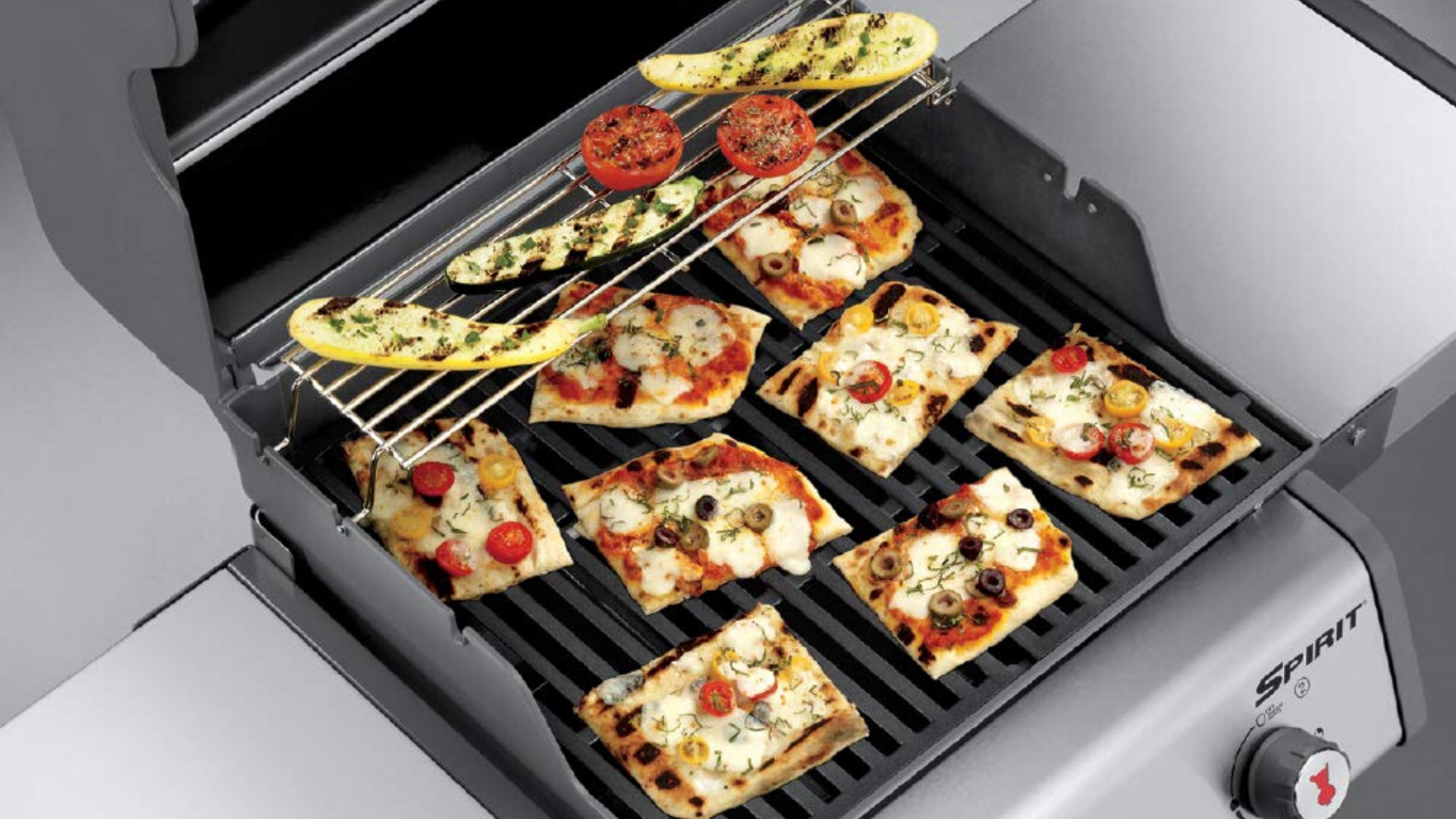 picture of pizza and veggies on weber spirit grill