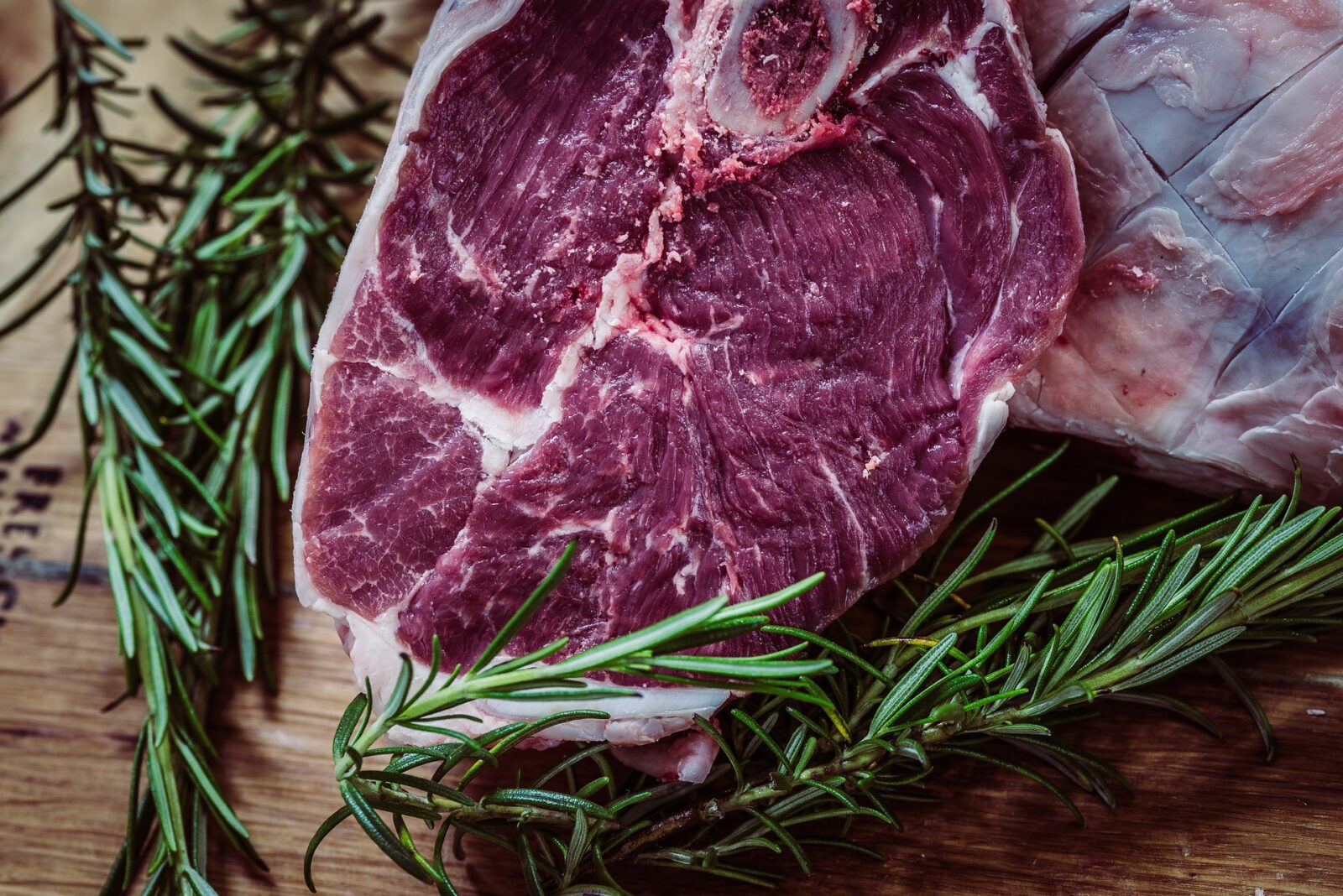 image of raw steak and herbs on board