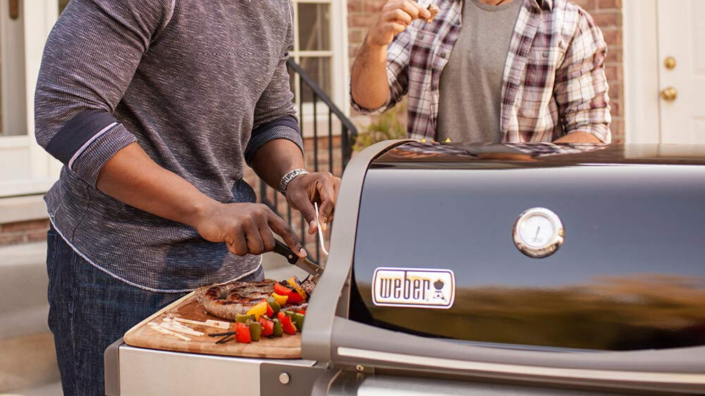 picture of men using weber spirit grill