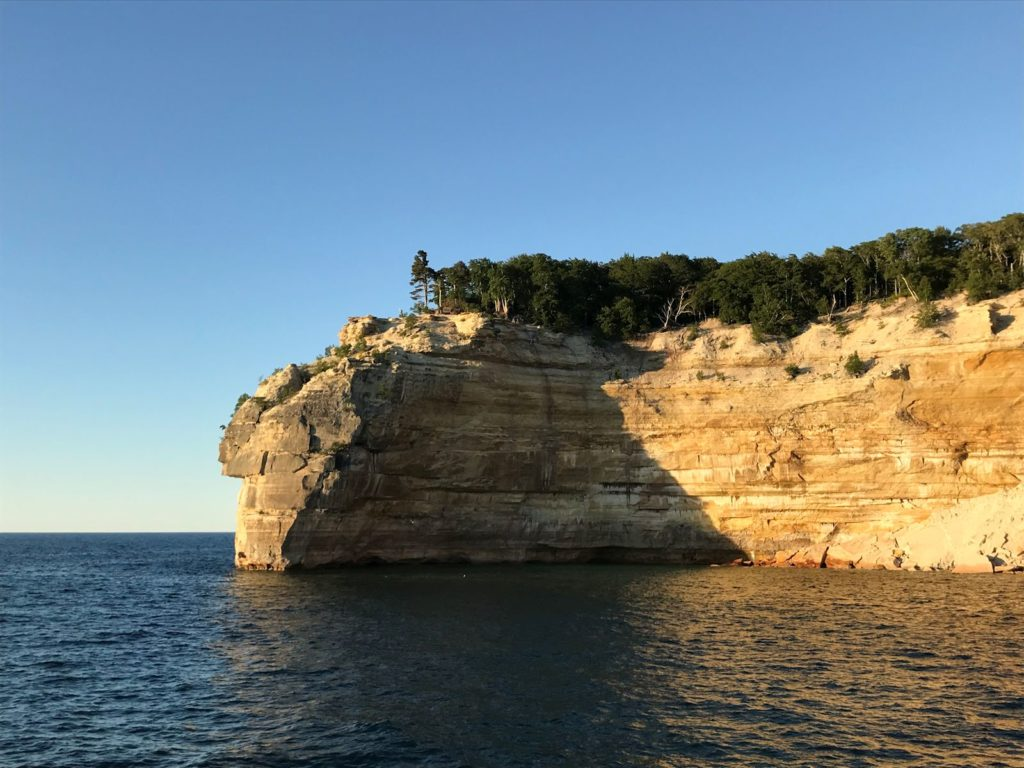 Photo of cliffs at Pictured Rocks National Lakeshore, late evening, from the water.