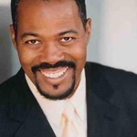 A man in formal wear, smiling