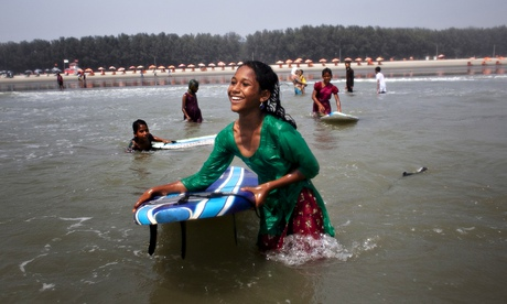 New wave … young girls surfing at Cox's Bazar, Bangladesh.