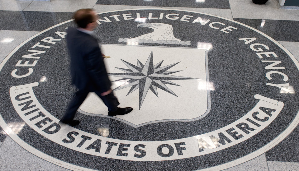 A man crosses the Central Intelligence Agency (CIA) logo in the lobby of CIA Headquarters in Langley, Virginia, on August 14, 2008. AFP PHOTO/SAUL LOEB (Photo credit should read SAUL LOEB/AFP/Getty Images)