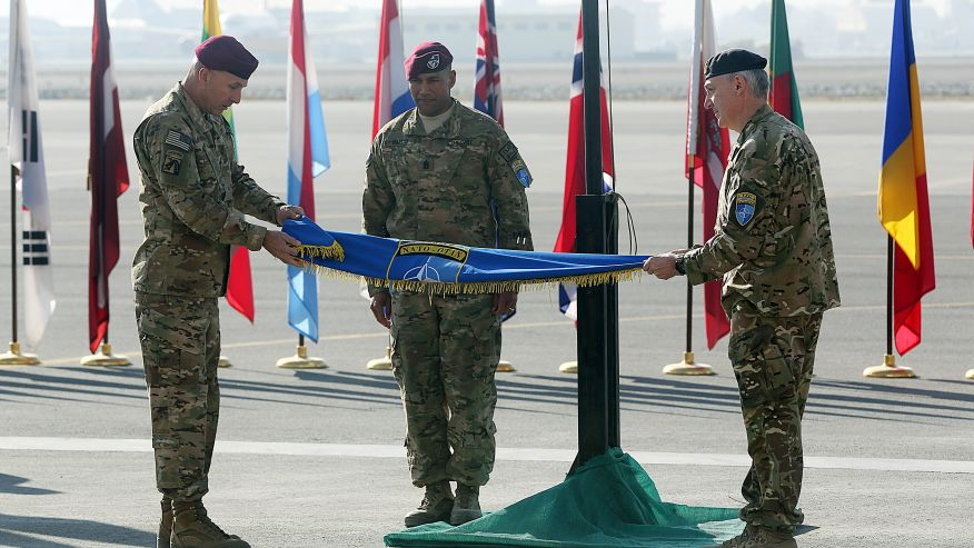 Dec. 8, 2014 - International Security Assistance Force Joint Command (IJC), Lieutenant General Joseph Anderson, left, folds the flag of IJC during a flag-lowering ceremony at Kabul International Airport in Afghanistan. The U.S. and NATO ceremonially ended their combat mission in Afghanistan Monday, 13 years after the Sept. 11 terror attacks sparked their invasion of the country. (AP)