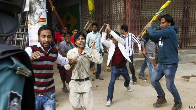 Police have been accused of standing by as Awami League supporters attacked opposition party members