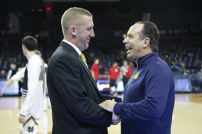 The coaches. Steve Howes for CUA and Mike Brey for Notre Dame interact before tip-off. Courtesy of cuacardinals.com
