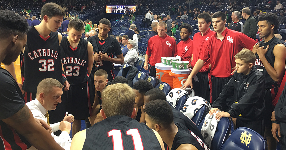The team and coach Steve Howes in the huddle at the Purcell Pavilion. Courtesy of cuacardinals.com