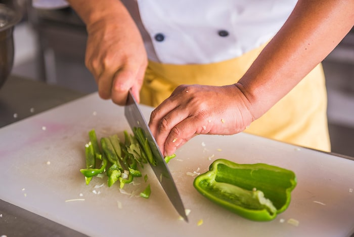 Chef chopping vegetables in the kitchen at Club Tapiz in the Maipu area of Mendoza, Mendoza Province, Argentina