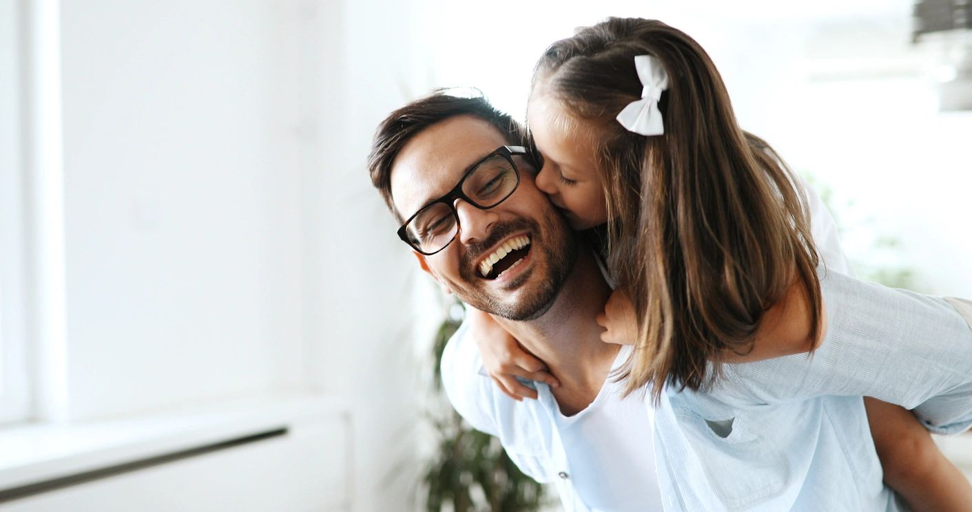 man and daughter smiling