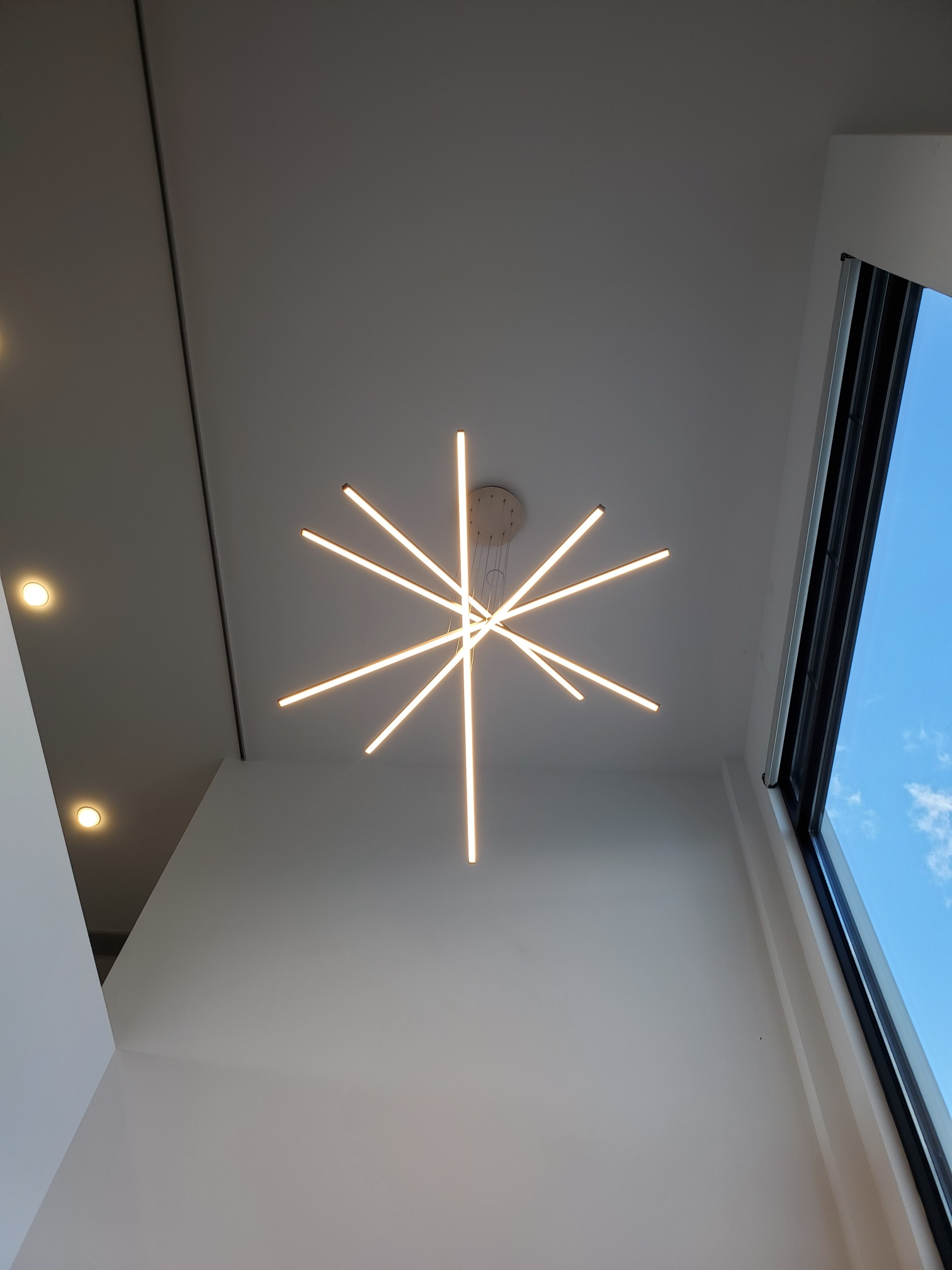 Specialty LED lighting with a custom fixture and recessed accent lighting